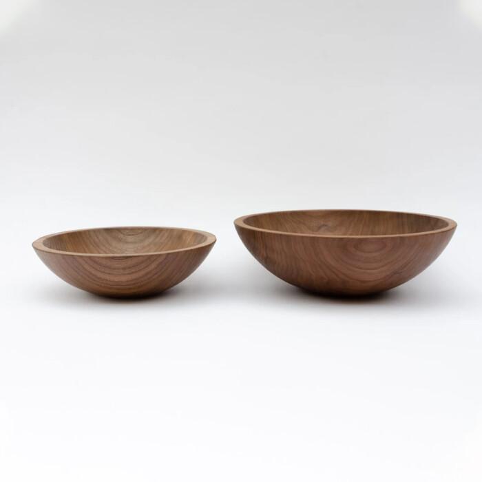 Handmade walnut wooden bowls on white background