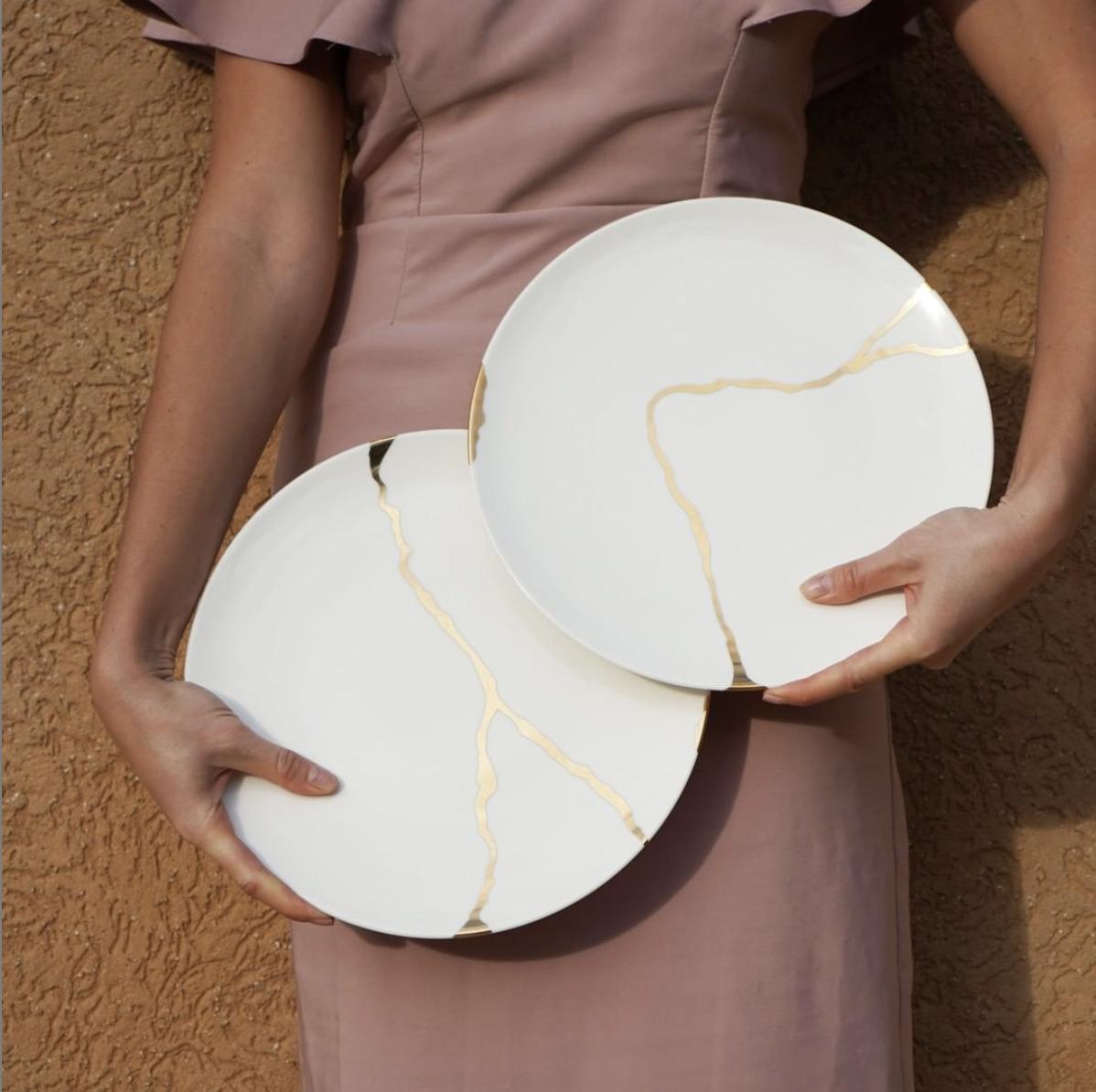 kintsugi plates held by woman