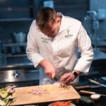 chef cutting bacon with sakai kyuba gyuto - japanese kitchen knives