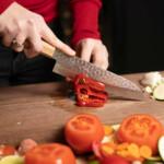 sakai kyuba classic cherry santoku knife cutting peppers