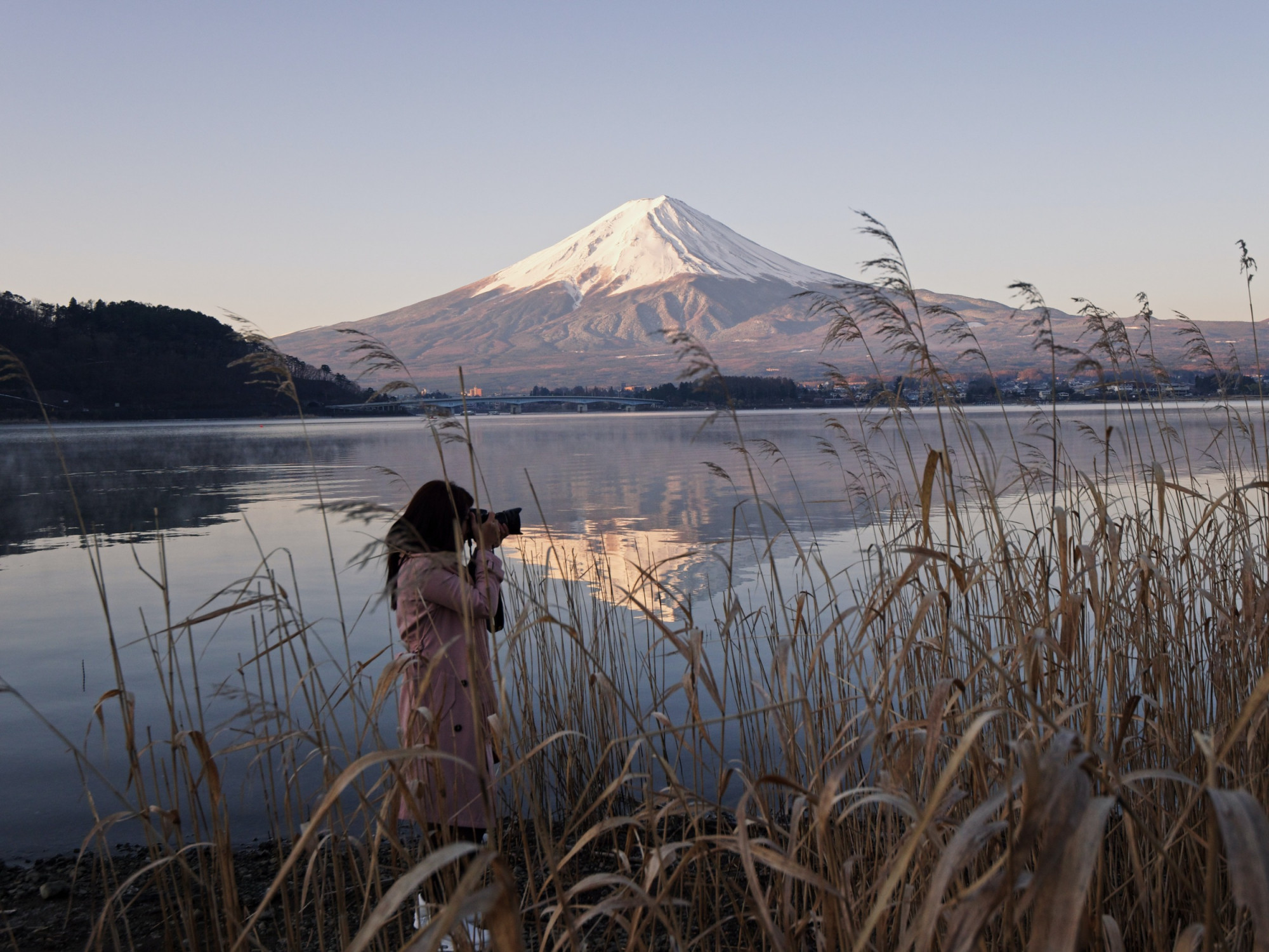 Woman photographing mount fuji