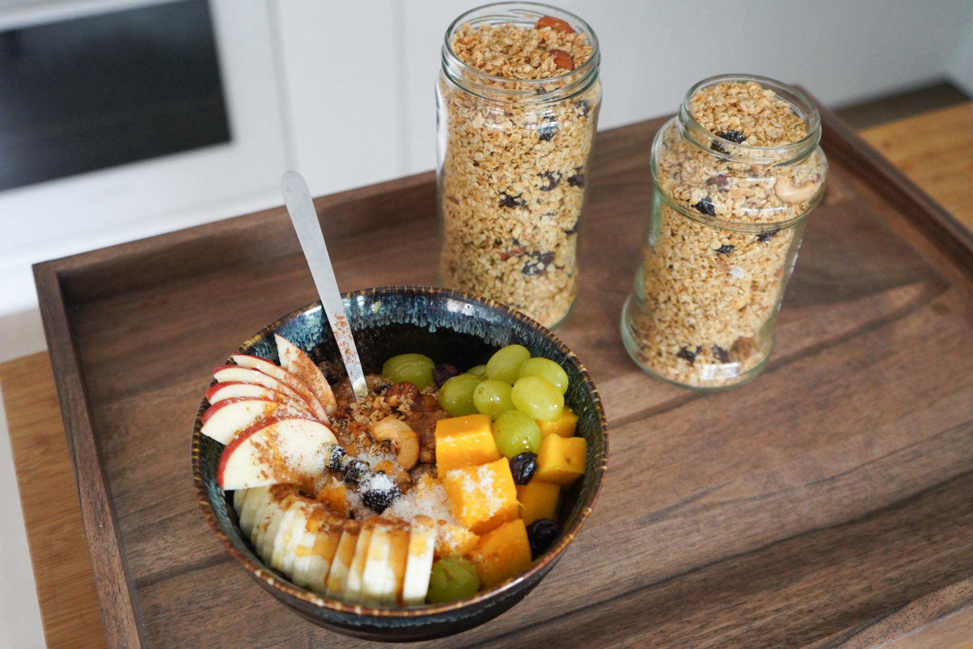 healthy granola breakfast on wooden tray